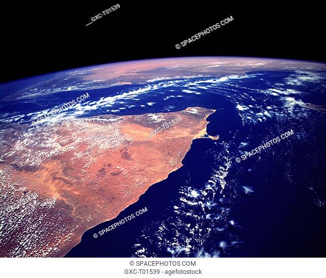 The orange and tan colors of this high-oblique photograph of the Horn of Africa indicate an arid-to-semiarid landscape in the northern half of the east African...