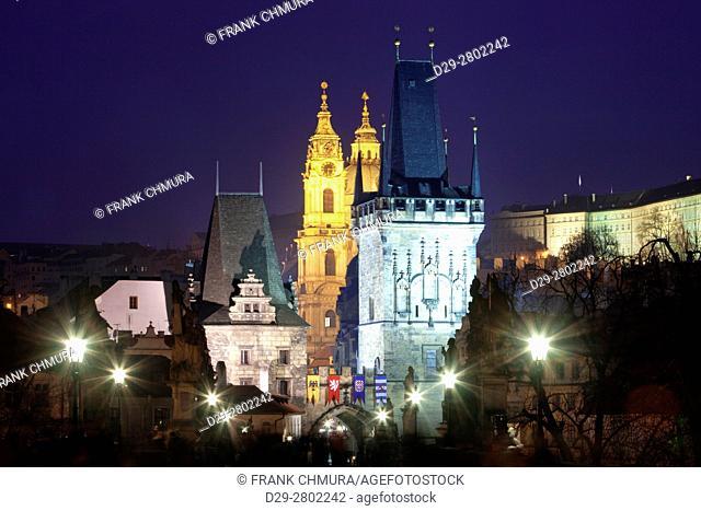 czech republic prague - charles bridge and st. nicolaus church at dusk