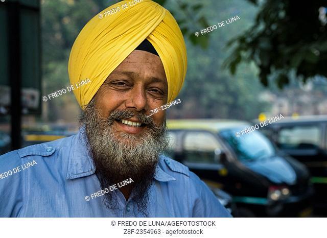 Taxi driver in New Dehli street