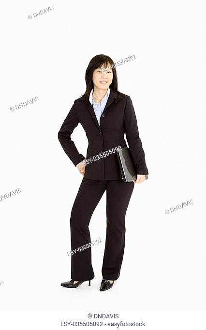 Beautiful Asain Businesswoman posing on a white background holding a laptop