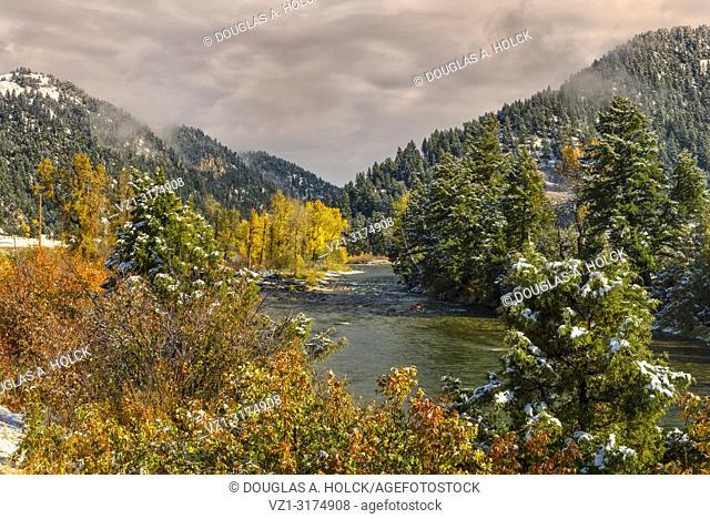 Snow on a Fall Day on Gallatin River Montona USA