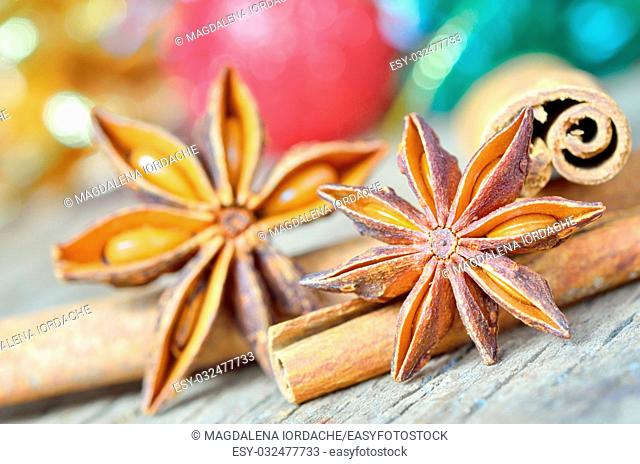extremely closeup view of anise star and cinnamon sticks, on wooden table