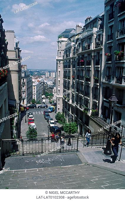 View from top of Sacre Ceour hill. Apartment blocks. People climbing steps