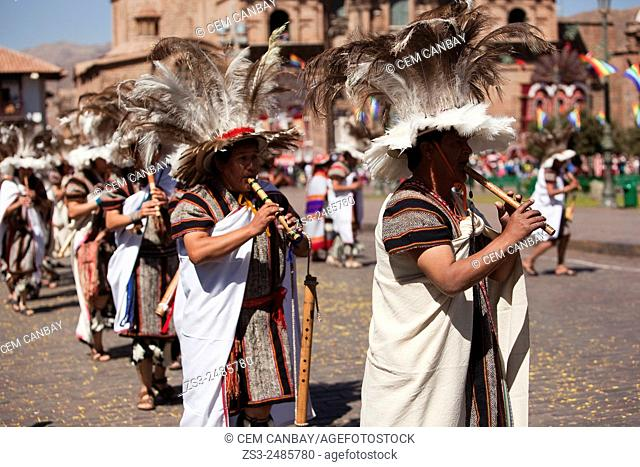 Scene from the celebrations of the Inti Raymi Festival with musicians in the foreground at Plaza de Armas, Cuzco, Peru, South America