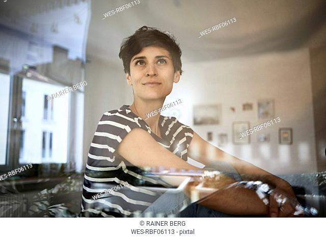 Portrait of woman at home thinking