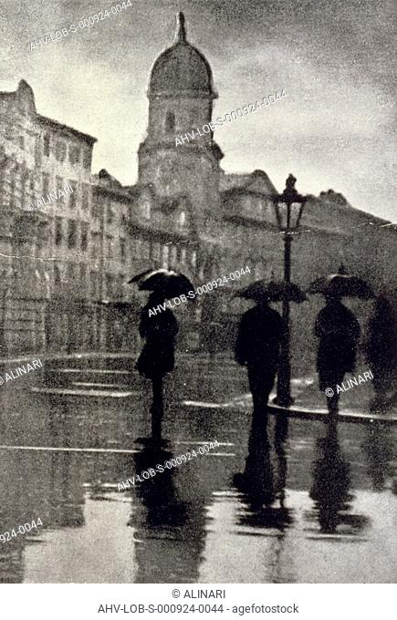View of a street in Fiume full of passers-by on a rainy November day, shot 1923-1924 by Corriere Fotografico,Bayer, Oscarre