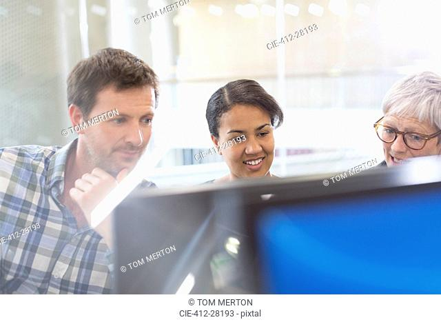Business people working at computer