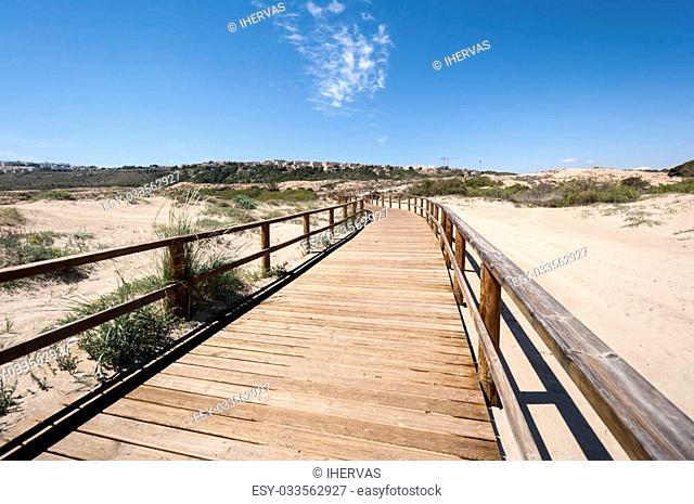 Wooden walkway over dunes. Photo taken in Carabassi beach, Elche, Spain