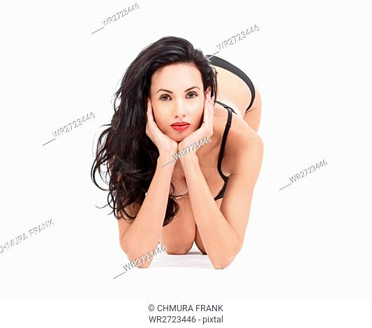 beautiful woman in black underwear looking at camera - isolated on white