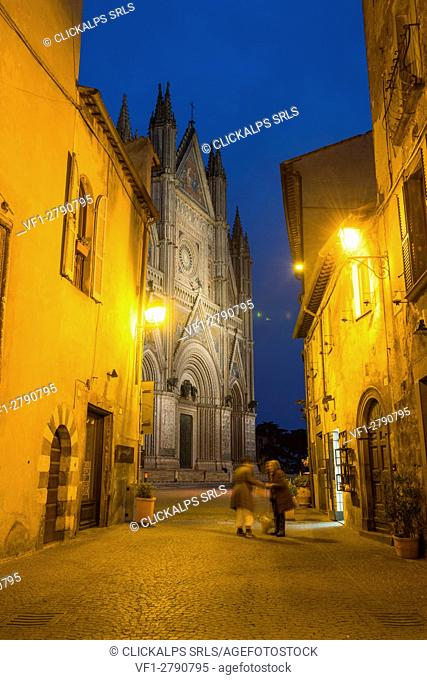 Orvieto, Terni, Umbria, Italy. The historic center at dusk with the cathedral's facade on the background