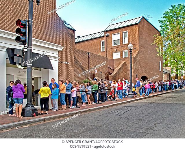 Customers line up on historic 32nd Street in Georgetown, Washington, D C , to purchase cupcakes at a local bakery  Georgetown is a neighborhood located in the...