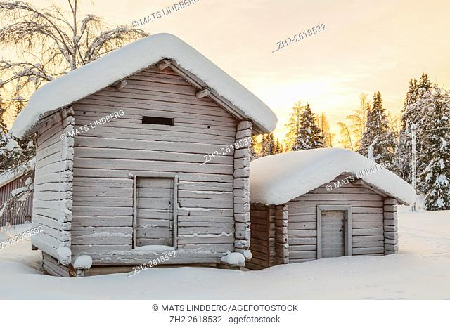 Old barns in winter time, plenty of snow around, frost on the doors, snow on the trees, Gällivare, Swedish Lapland, Sweden