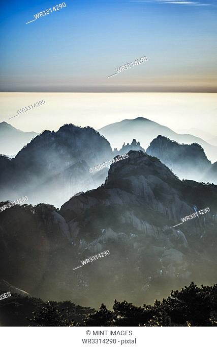 Fog rolling over rocky mountains, Huangshan, Anhui, China