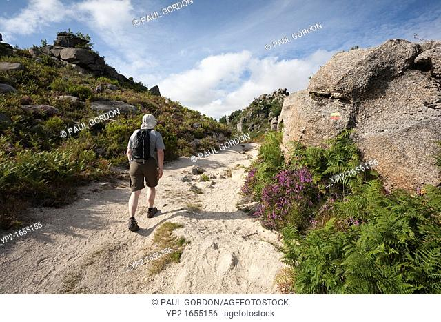 Man hiking along the Pedra Bela Trail - Gerês, Peneda-Gerês National Park, Braga District, Norte Region, Portugal