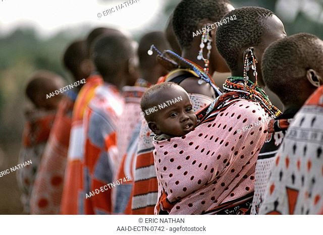 A Maasai baby strapped to its mother's back in the Masai Mara in Kenya