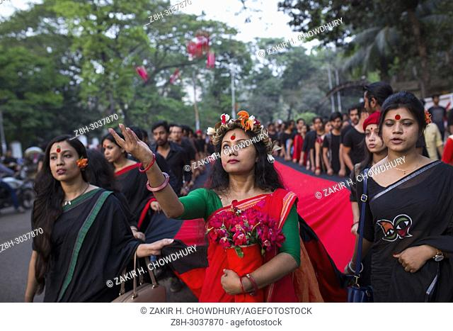 DHAKA, BANGLADESH - MARCH 25 : Prachyanat School of Acting and Design take out a procession Lal Jatra (Red Procession), to remember making the genocide by...