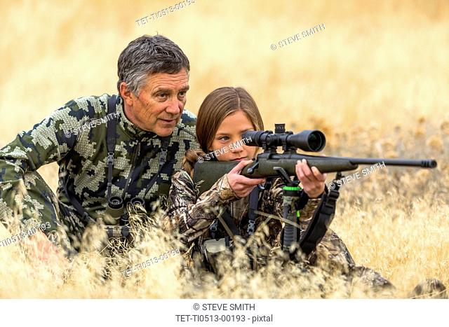 Man hunting with his granddaughter