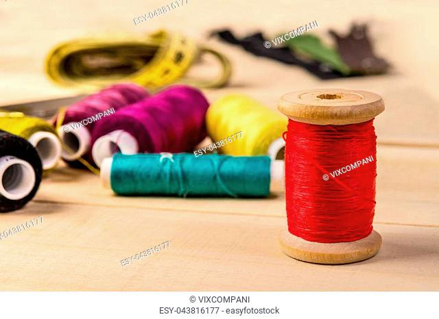 Wooden coil with red thread