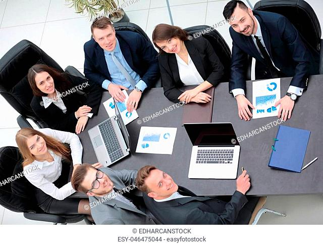 business team works with the financial schedules in the office
