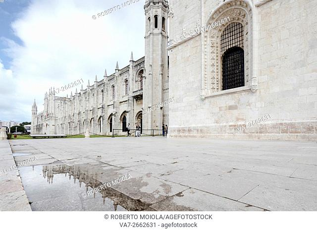 Hieronymites Monastery with its late gothic architecture is reflected in a puddle Santa María de Belem Lisbon Portugal Europe