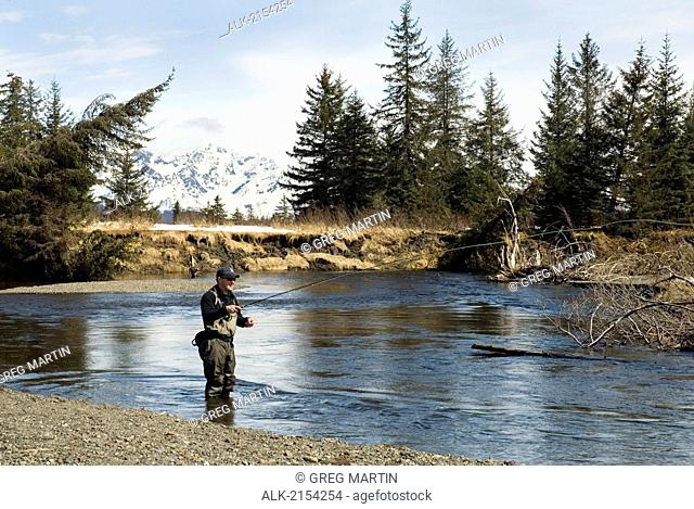 Fisherman Casting For Steelhead In The Situk River On A Sunny Spring Day In Southeast Alaska