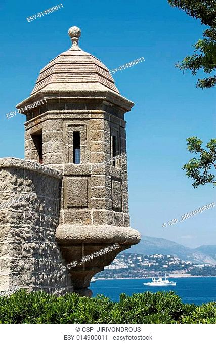 Monte Carlo palace wall with watch tower overlooking the Mediterranean ocean, Monte Carlo, Monaco