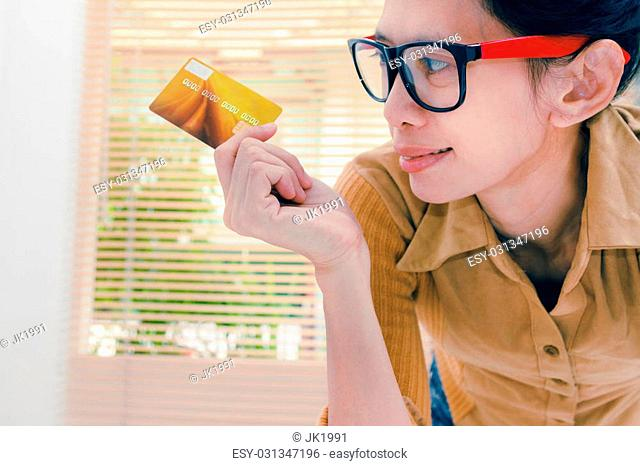 Beautiful woman showing credit card for online payment, hands holding a credit card and using for online shopping,shopping card,shopping content