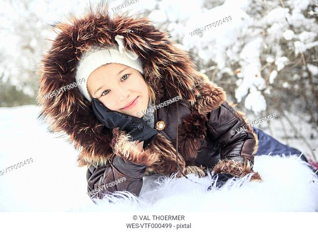 Portrait of smiling girl in winter
