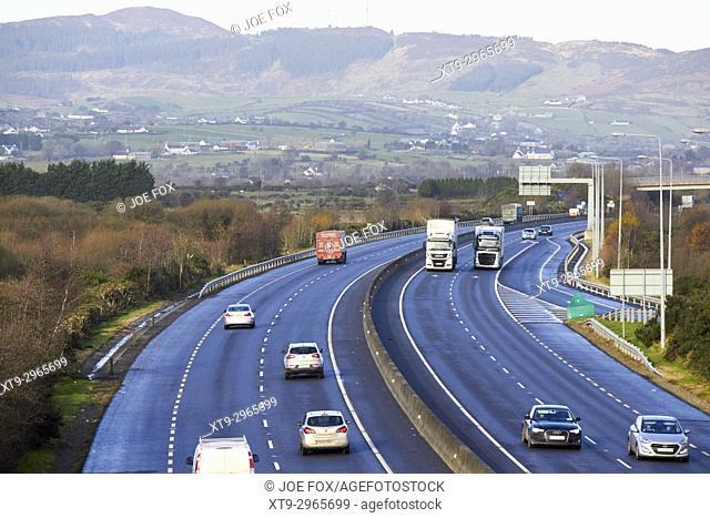 cross border traffic on the N1/M1 motorway crossing the irish border between Northern Ireland and Republic of Ireland soon to be the UK EU land border post...