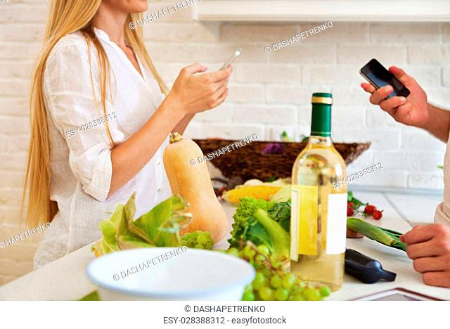 Happy young couple cutting vegetables at the kitchen. Couple preparing dining. Close up