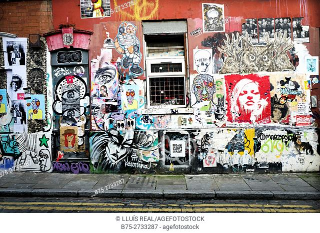Street art and Graffiti on house wall. Grimsby St. East End, London, England