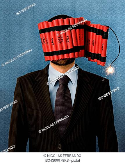 Businessman wrapped in dynamite