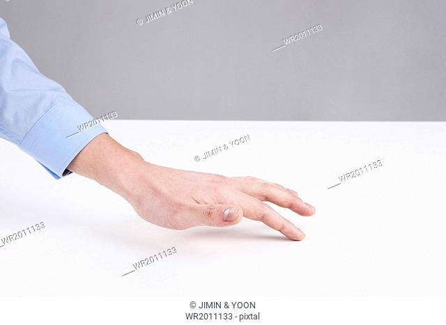 a hand touching the surface