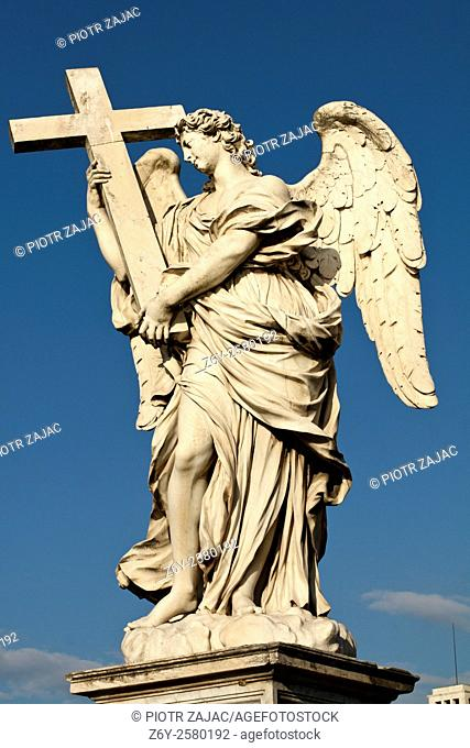 Sculpture of Angel with the Cross by Ercole Ferrata on Ponte Sant'Angelo also known as Bridge of Hadrian in Rome, Italy