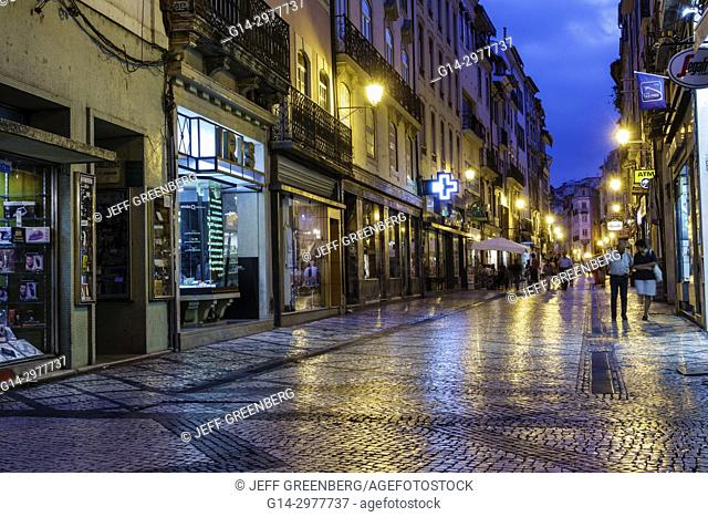 Portugal, Coimbra, historic center, Rua Ferreira Borges, business, commercial district, storefronts, shopping, pedestrian mall, dusk, lighting, reflection