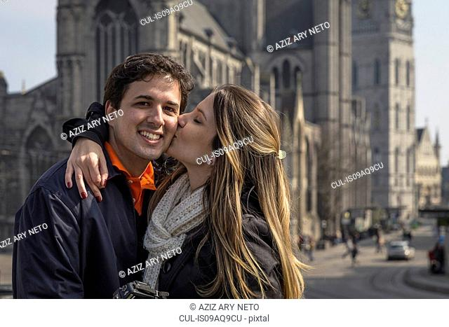 Romantic couple in front of St Bavo's Cathedral, Ghent, Flanders, Belgium