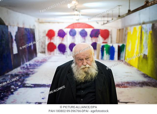 01 August 2018, Austria, Prinzendorf an der Zaya: The Austrian painter and action artist Hermann Nitsch stands in front of some of his works at his studio at...
