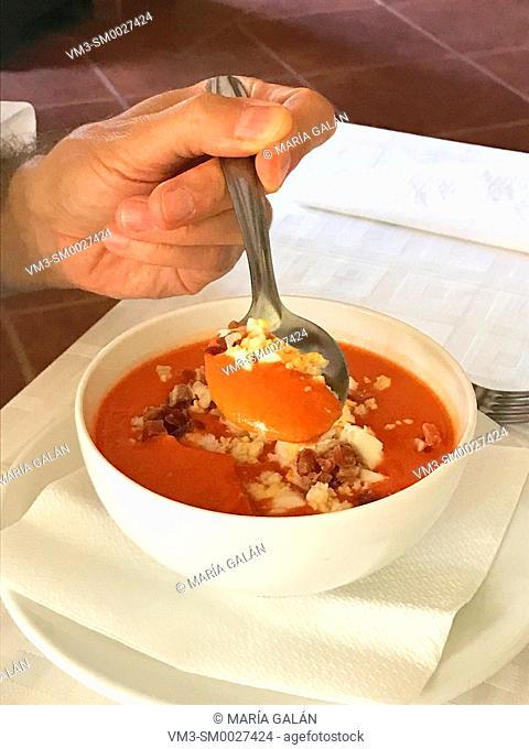Eating salmorejo cordobes. Spain