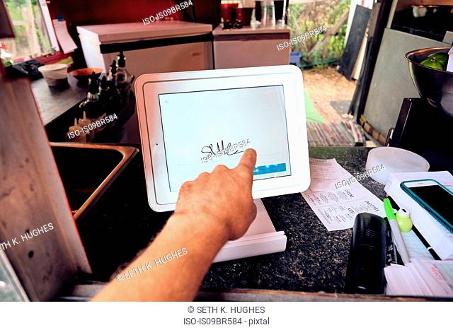 Digital screen for food orders and payment at eatery