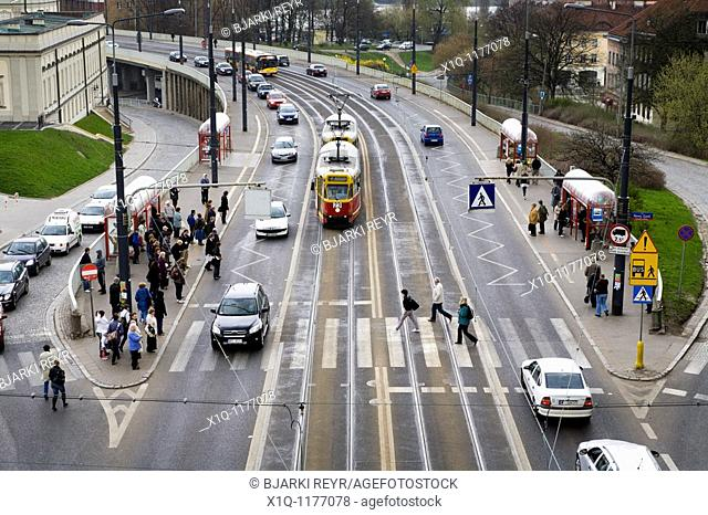 Cars, trams and people on Solidarity Avenue Aleja Solidarnosci, one of the main thoroughfares in Warsaw Poland