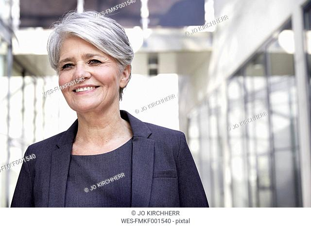 Portrait of smiling career woman in a modern building
