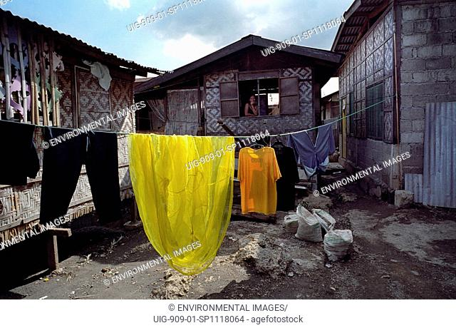 SLUMS, PHILIPPINES. Cebu City.These families are too poor to buy homes inland with access to clean water. . They are forced to build makeshift houses along...