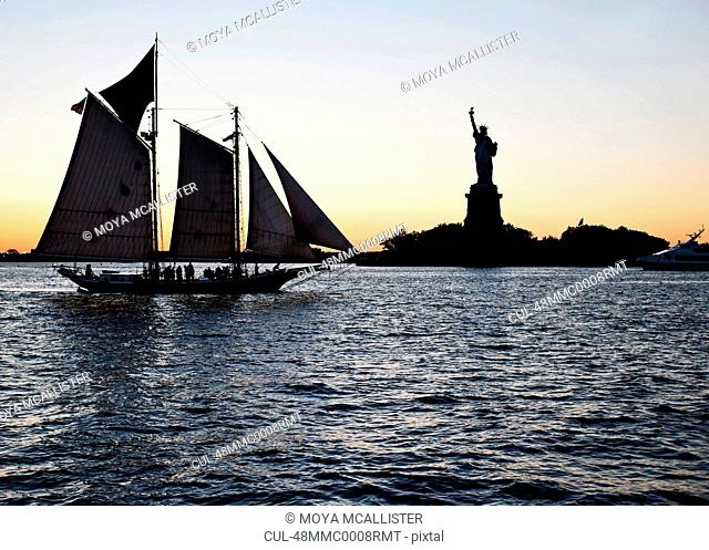 Boat passing by Statue of Liberty