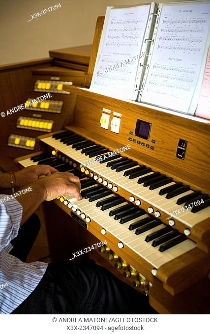 Man playing the organ in church