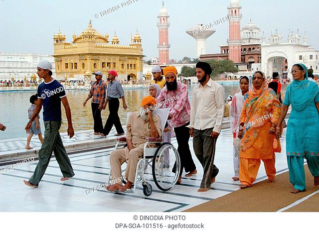 Sikh devotees walks around Golden temple ; Amritsar ; Punjab ; India