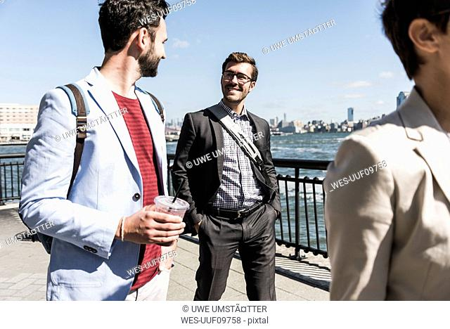 USA, colleagues walking at New Jersey waterfront