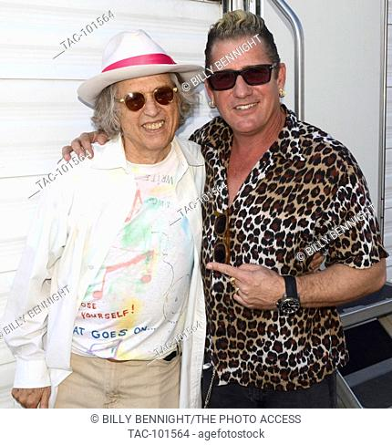 Stephen Kalinich and Lee Rocker attends the 25th Annual Sherman Oaks Street Fair Featuring The Stray Cats' Lee Rocker in Sherman Oaks, California on October 18