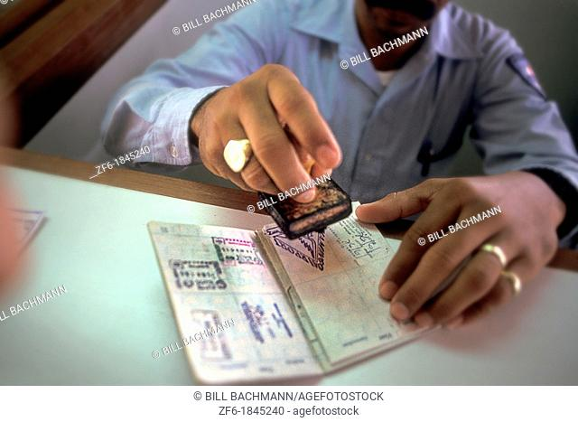 Customes Official Stamping Passport in the Caribbean