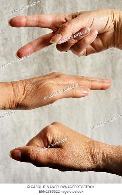 "Three hands playing """"rock-paper-scissors"""""