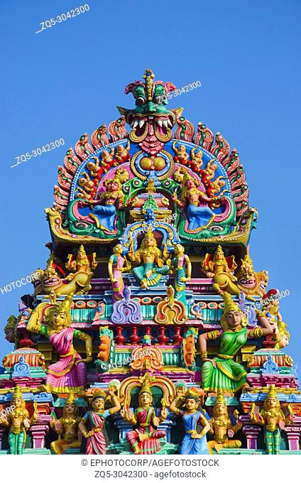 Sculptured facade of the Kapaleeshwarar Temple, Mylapore, Chennai, Tamil Nadu, India. Shiva Temple. Form of Shiva's consort Parvati worshipped at this temple is...